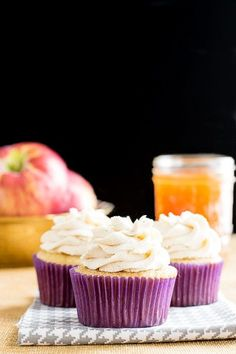 Apple Cider Cupcakes: A moist apple cider cupcake with a tender crumb. The cupcakes are topped with a layer of cinnamon sugar and a cinnamon cream cheese whipped cream.