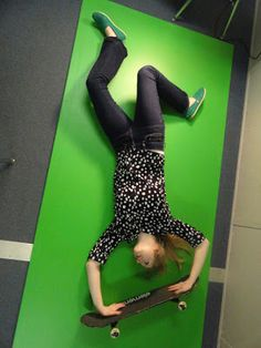 By placing the green screen on the ground it makes it easier to take photos of yourself doing cool skateboard tricks. The other reason to put the green screen on the ground is because it is too big to put upright.