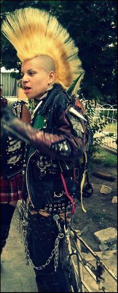 Huge mohawk,  huge spikes in leather jacket, male punk
