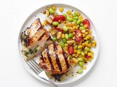 Simple but vibrant succotash accompanies this spicy chicken stuffed with pepper Jack cheese and fresh arugula.