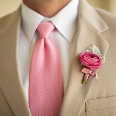 The groomsmen wore pink roses backed by dusty miller, matching perfectly with their pink ties.