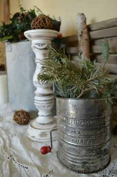 Great use of that old sifter for winter kitchen decor.