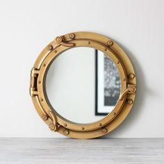vintage ship port hole mirror....find something like this cheaper for halens room