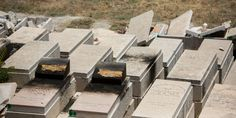 A view of desecrated Jewish tomb stones that were burned and destroyed on the Mount of Olives cemetery in East Jerusalem on June 23, 2015. (Photo: Yonatan Sindel/Flash90)