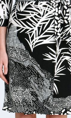 Contrast, movement  (The different shapes and images of flowers/plants create contrast in this garment, along with the contrast in black and white. The repitition seen here creates movement)