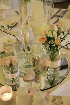 Around the base of each of the tall designs we'd arranged posies of fresh flowers to decorate the table top