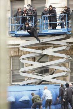 stunt double ensuring the fall will be safe for Ben