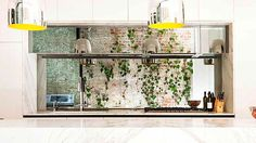 Australian House & Garden interior decorating advice column on how to incorporate a mirrored splashback in your kitchen.