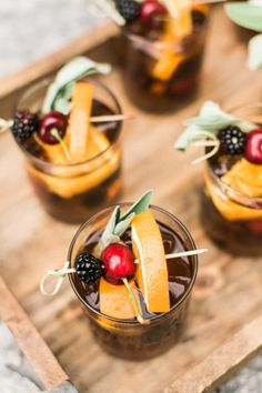 These delightful cocktails by Royal Fig Catering are perfectly balanced with lovely fruit garnish. Photos by Mint Photography. #royalfigcatering #austinweddings #styledshoot #austin #pearlevents
