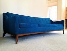 Long Mid Century Sofa In Blue Color For Simple Living Area With ...