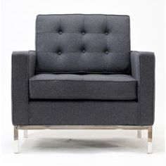 Sharply charcoal gray chair with tuffted back pillow for reception area . Über chic.