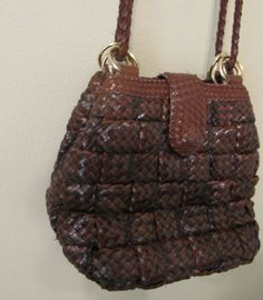 vintage brown braided basket weave purse with long strap. $22.00, via Etsy.