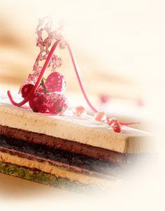 Tra Di Noi - Pistachio Dacquoise, Praline mousse, flourless chocolate biscuit, forest fruit gelatine, ganache and vanilla chantilly cream