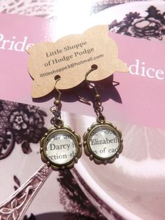 I think all these fun literary earrings would be nice as charms to add to a reading or book bracelet!