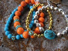 Gold, Silver, Orange and Turquoise with some Swarovski bling