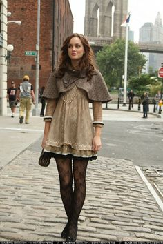 Blair Waldorf (1x9). Trina Turk espresso capelet crop jacket in brown tweed, Marc by Marc Jacobs Dita lace dress, black lace Wolford tights, and tuart Weitzman black lace Heart Throb pumps.