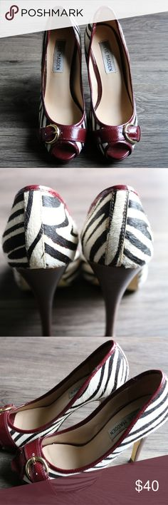 Steve Madden Zebra and Maroon Heels 5.5 Steve Madden brand. Zebra style made of animal hair. Maroon detail, including bucklefront. Peep toe. Size 5.5. Leather upper. Steve Madden Shoes Heels