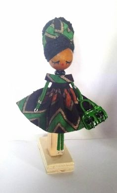 handmade handpainted size: 9cm/ 3.54 inches Small dolls made by hand and with all details. These brooches jewelry is completely hand made. Wooden heads and miniature dolls are made by hand with high quality materials, the small dresses are hand stitched in exclusive fabric and the