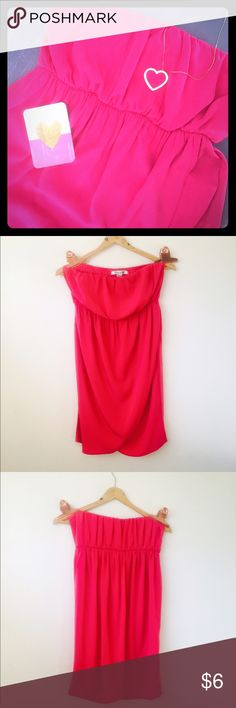 Forever 21 Tulip 🌷 Dress Forever 21 Tulip 🌷 Dress. Size L. Pink. Sad to see this dress go, but  I need to clean out my closet for some new stuff 🙂. This cute piece has a tulip bottom. It isn't lined, but it's not see through at all. Hits about mid thigh (I'm 5'2). Forgiving bust. Elastic tube top. Elastic waist. Super cute fit. Pair with a  and cowboy boots!!! Let me know if you have any questions- just tag me!!! Forever 21 Dresses Mini