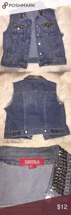 Forever 21 denim vest Studded cutoff denim forever 21 vest. Great condition I only wore it around five times. Has silver studs on pockets and around the collar. No flaws or missing studs. Size small. Forever 21 Jackets & Coats Vests