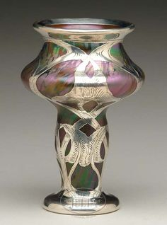 """LOETZ SILVER OVERLAY VASE. The epitome of Art Nouveau is well represented in the silver overlay design of this vase. The multicolored vase has a wonderful iridescent finish. SIZE: 6-1/4"""" t"""