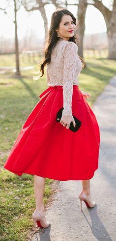 Shop this look on Lookastic:  http://lookastic.com/women/looks/beige-long-sleeve-t-shirt-red-midi-skirt-black-clutch-beige-pumps/7703  — Beige Lace Long Sleeve T-shirt  — Red Pleated Midi Skirt  — Black Suede Clutch  — Beige Leather Pumps