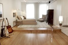 simply raising the levels in this long & narrow room give the spaces definition by Tori Golub for a Soho Loft