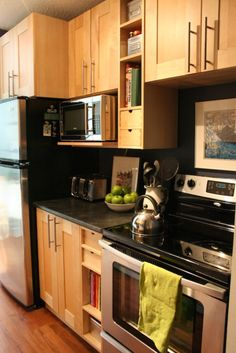 The cabinetry is from Ikea - Adele cabinets in birch.  (probably did 15 different mockups on the IKEA kitchen planner to find a plan that fit the small space, was most efficient, and cost effective).