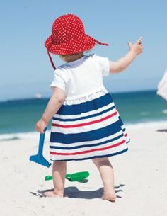 I can't help myself...I'm a sucker for cute babies in hats....and beaches....and all things related to the Fourth of July :)