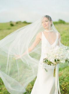 Island style wedding dress: Photography: Aria Studios - ariastudios.com Read More on SMP: http://www.stylemepretty.com/2017/04/21/an-elegant-island-style-elopement/