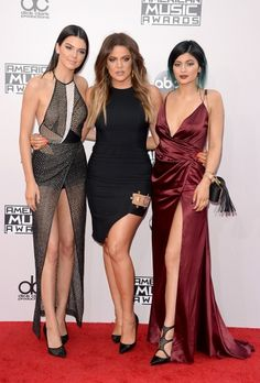 Kendall Jenner, Khloe Kardashian and Kylie Jenner attend the 2014 American Music Awards at Nokia Theatre L.A. Live on November 23, 2014 in Los Angeles, California.