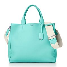 High-quality Italian leather and T-shaped accents define Tiffany leather designs. Add a personal touch to your bag or wallet with a Tiffany bag charm that is sure to make a statement. Tiffany Blue Box, Tiffany & Co., Tiffany Blue Vans, Tiffany Gifts, Bags Online Shopping, Vide Poche, Mint, Turquoise, Aqua Blue