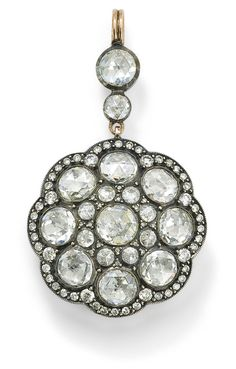 A diamond pendant  The gently scalloped circular pendant set with rose- and circular-cut diamonds to a similarly cut diamond spacer and surmount, length 5 cm.