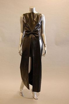 Black vinyl evening gown with front slit to waist (revealing shorter skirt underneath), by Jean Paul Gaultier, French, late 1990s.