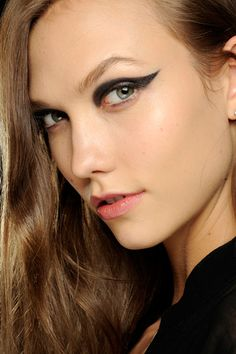 EYELINER FLICKS - Heavy black at Lanvin, disconnected lines at Mary Katrantzou, triangular flicks at Erdem and geisha-style monochrome eyes at Zac Posen - classic flicked eyeliner was given a modern update.