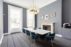 Our Rome chandelier is elegantly suspended over this meeting room table in the Office Suites, Harcourt Street Dublin. Design: Think Contemporary.   #mullanlighting #madeinireland #chandeliers #officeroomlighting #opalglobes