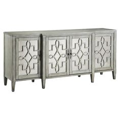 Showcasing mirrored fronts and 4 doors, this lovely sideboard is perfect for stowing spare table linens or dinnerware in your dining room or kitchen.    ...