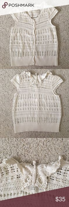 👚Anthropologie Beige Cap Sleeve Butterfly Sweater So cute! Great condition. Loosely woven cap sleeved sweater from Anthropologie by Knitted and Knotted. Great detailing including butterfly at back of neck. Beige. Small barely noticeable mark on back as shown on pic. Anthropologie Sweaters Cardigans