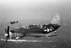 Helldiver aircraft of USS Hancock in flight November 1944. Note F6F-5 in the background.