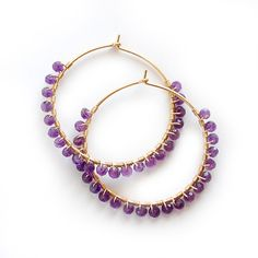 Handmade hoop earrings are wire wrapped with glittering, faceted rich purple amethyst stones. Available in 14 karat gold-filled or Argentium silver in two stock sizes: Small - inch cm) Wire Jewelry, Jewelry Shop, Antique Jewelry, Jewelry Design, Jewelry Making, Jewelry Stores, Gold Jewelry, Beaded Jewelry, Jewelry Rings