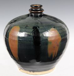 CHINESE POTTERY - Hanan Black Glaze Vase with russet splashes, in ovoid form with narrow neck. 7 3/8