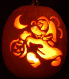 Pumpkin carving using Disney and Universal themed stencil patterns.