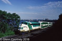 There was a time when GO Transit had quite a variety of locomotives leading its trains. Like many commuter agencies it expanded its network in fits and starts and its motive power followed suit. GO 904 was one of GO's APCU fleet (Auxiliary Power Control Unit), F units that no longer powered the train but provided power to the cars and a cab when the train was in push mode. I likely would not attempt a shot from this location today. This is train #982 deadheading back to Willowbrock for the ... Go Transit, Railroad Pictures, Rail Car, Train Engines, Rolling Stock, Train Journey, Control Unit, Diesel Locomotive, Jazz Age