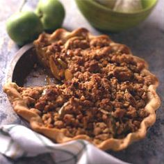 The top crust on this old favorite French Apple Pie features walnuts, raisins and fresh gingerroot.