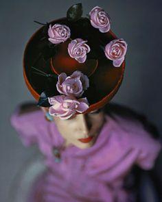 John Rawlings - Vogue USA, 1944 #millinery #judithm #hats Wonderful photograph. Half a dozen roses seems just right.
