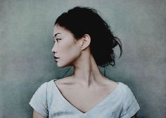 """A portrait with a nice """"twist:"""" the model faces front and stands center in the composition, but her face is to the side, in profile. Wonderfully muted color scheme too."""