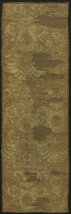 Yuan Dynasty. Cloth of Gold with displayed falcons. Lampas, silk and gold thread. Nasij, a silk textile woven with a preponderance of gold on the surface, was especially significant to the Mongols and was used for men's garments and the collars and cuffs of the robes of noblewomen. 57.5 x 18.4 cm. Purchase from the Edward L. Whittemore Fund . The Cleveland Museum of Art.