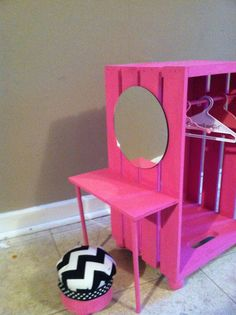 Closet and vanity all in one (looks like a painted wooden crate with a mirror and added piece of wood and dowels)