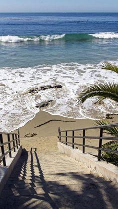 Walking down to the sandy shore, at Laguna Beach, CA.