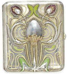A beautiful silver cigarette case with a flower motif design in the Art Nouveau style